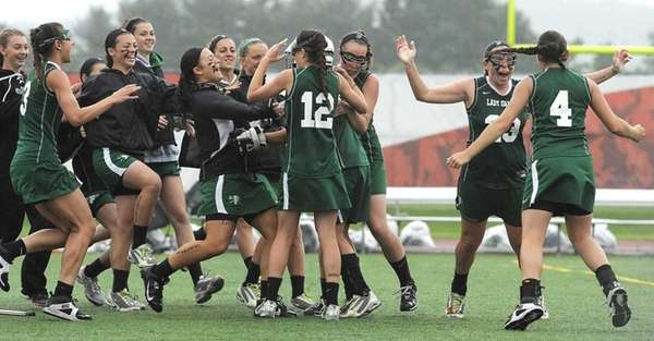 Farmingdale players celebrate after the final whistle following
