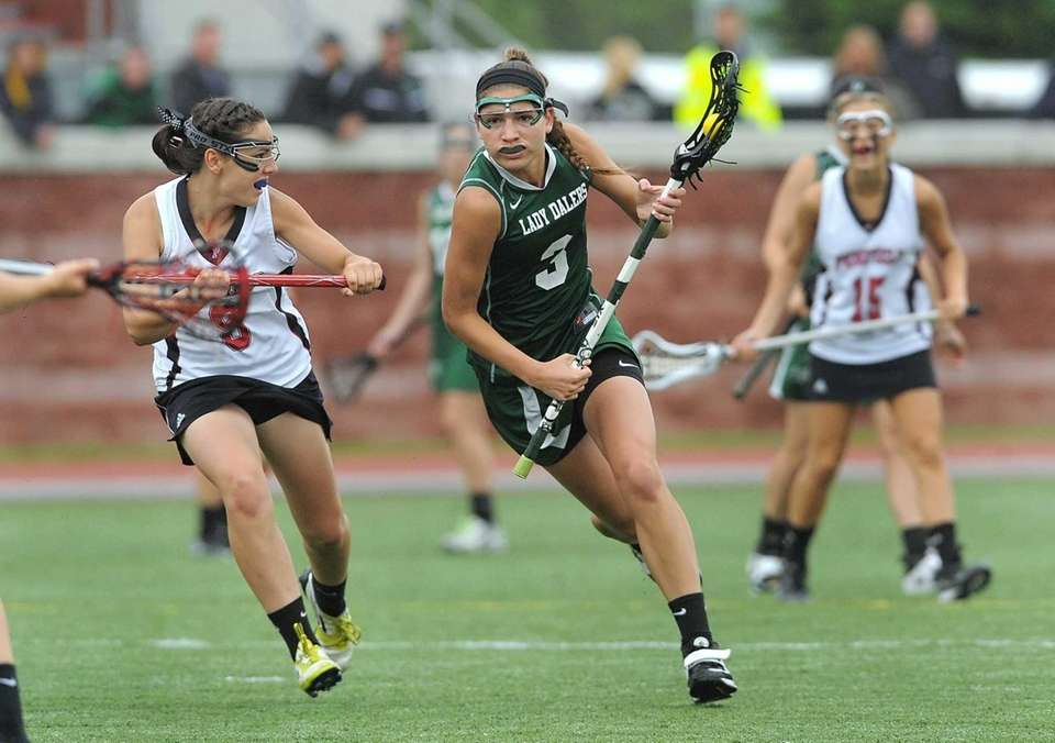 Farmingdale's Emily Marlow, center, carries the ball up