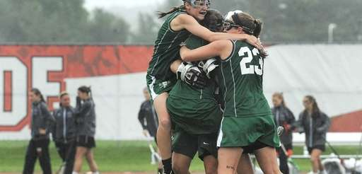 Farmingdale's Laura Fullam, left, joins the celebration with