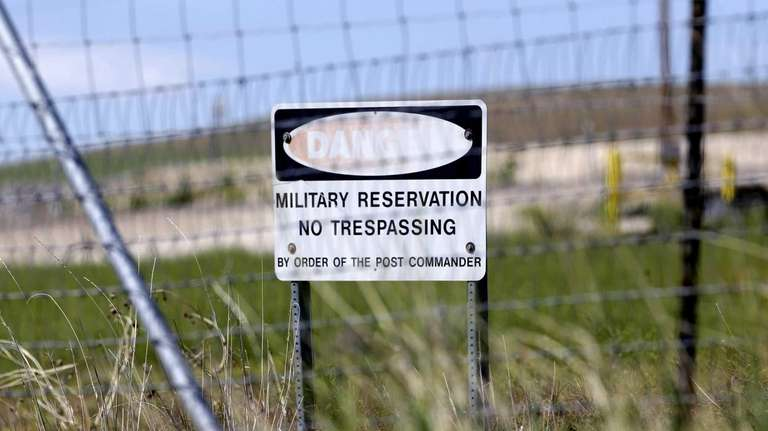 A military no trespassing sign is seen in