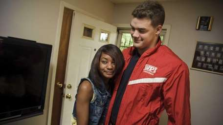 Bria greets lifeguard Ryan Mathie, who helped rescue
