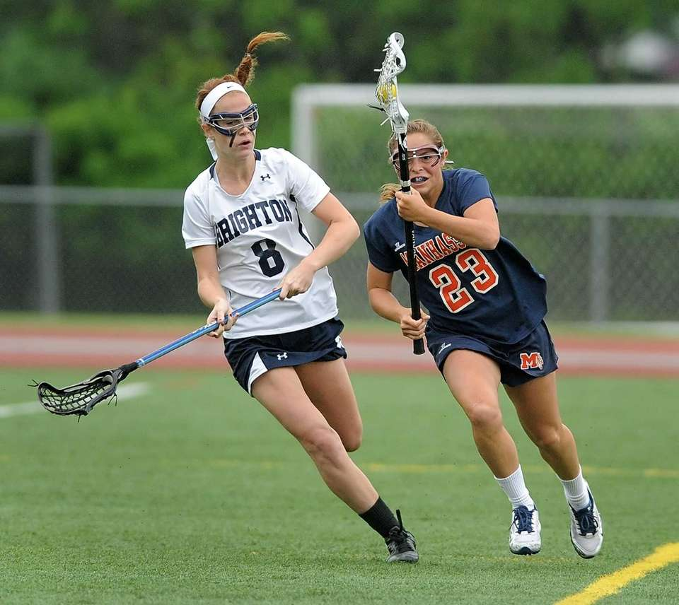 Manhasset's Kathryn Hallet, right, carries the ball up