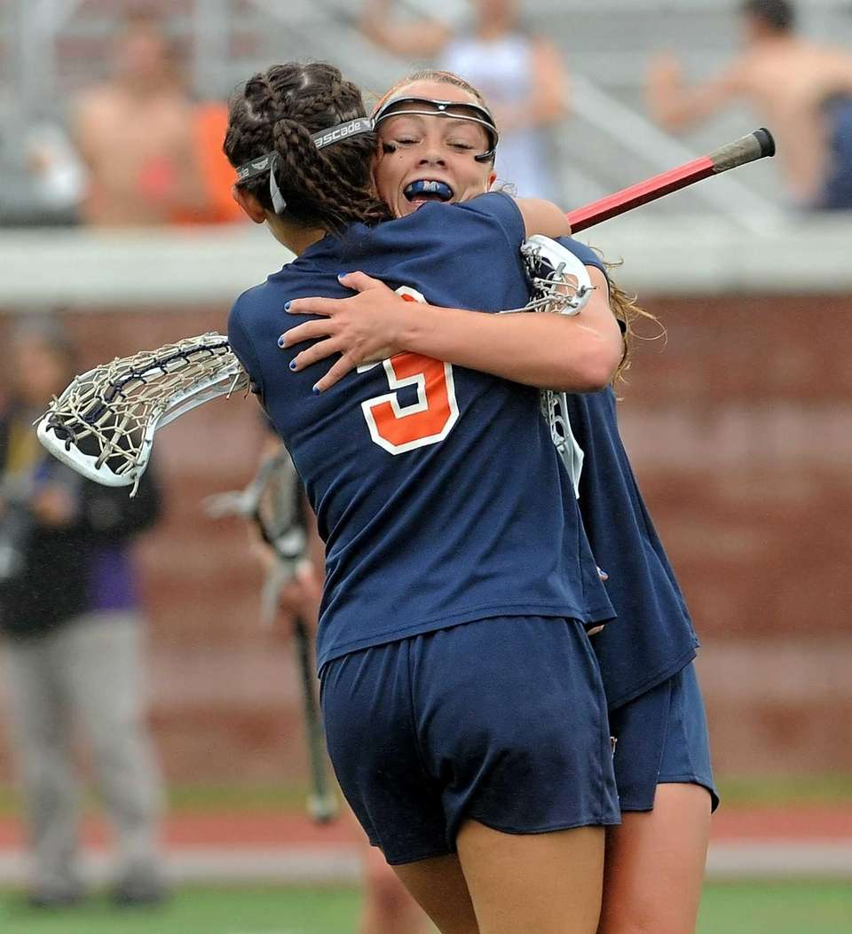 Manhasset's Lindsey Ronbeck, facing, celebrates her game-tying goal
