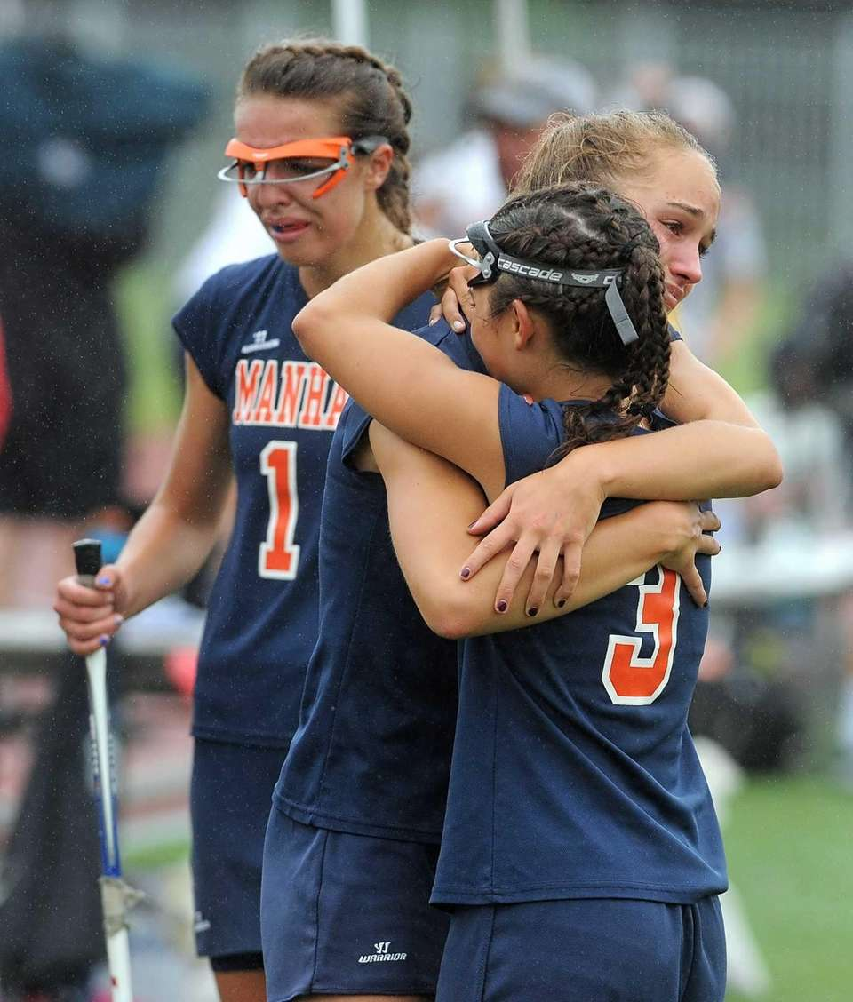 Manhasset's Natalie Stefan, facing, consoles teammate Sarah Barcia