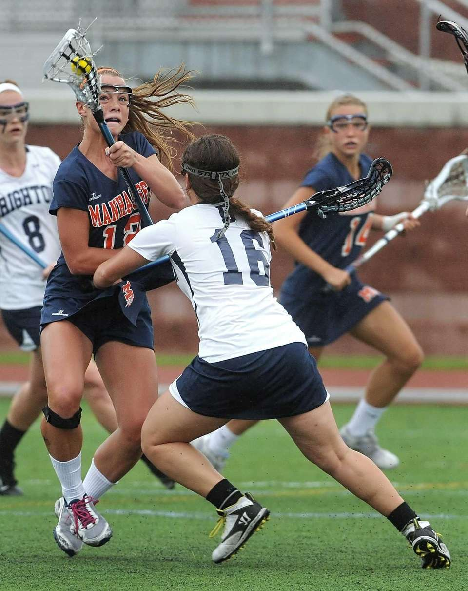 Manhasset's Lindsey Ronbeck, left, turns the ball away