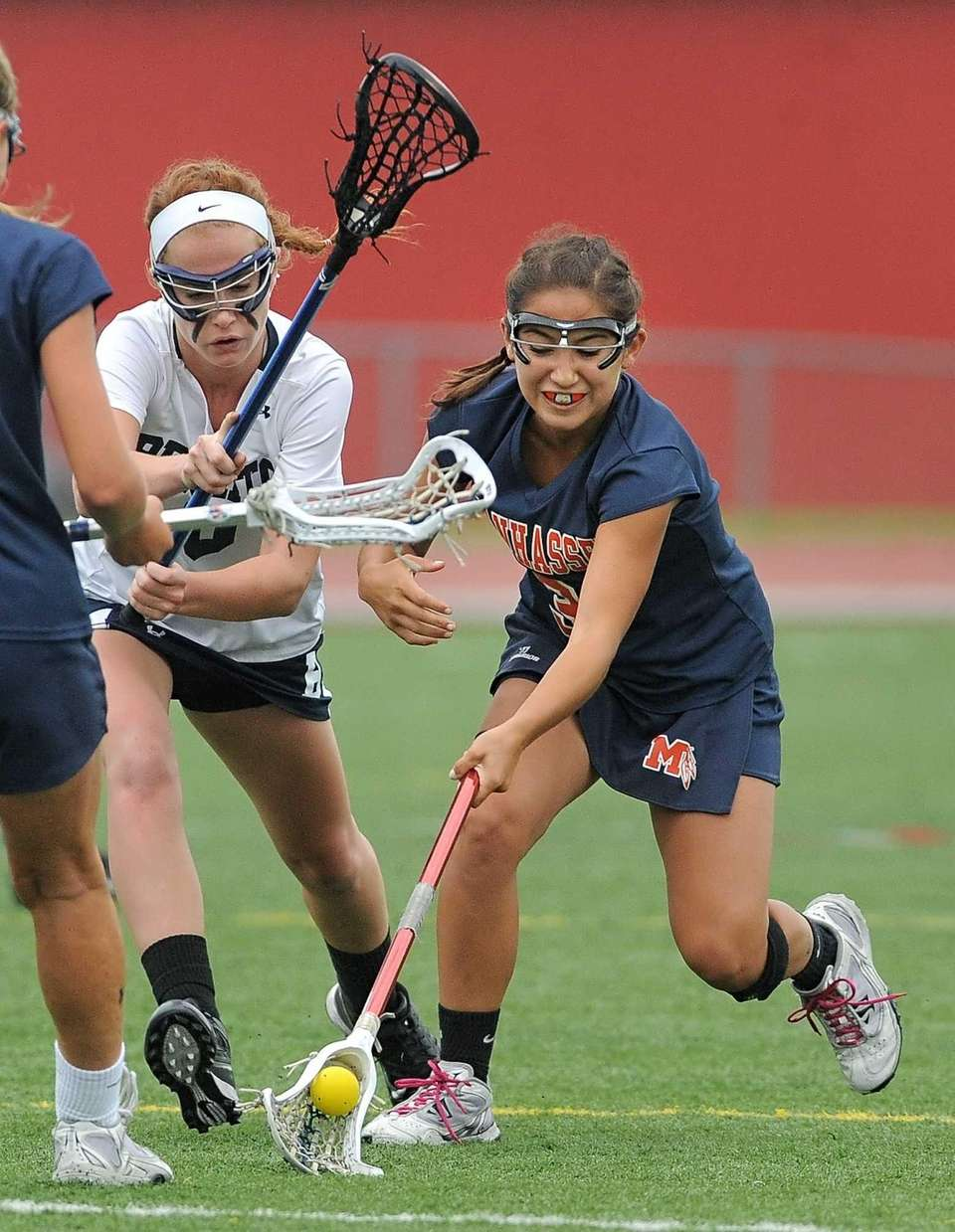 Manhasset's Sarah Barcia, right, scoops up a loose