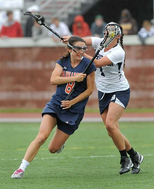 Manhasset's Julia Glynn, left, avoids the pressure from