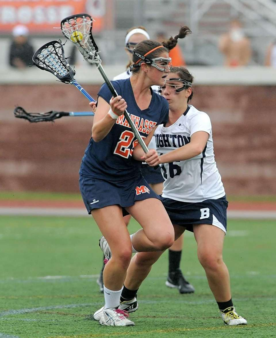 Manhasset's Kellen Dalleva, left, moves the ball by