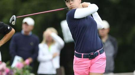 Morgan Pressel hits a tee shot on the