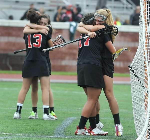 Mount Sinai's Alex Flobeck, right, hugs Kasey Mitchell