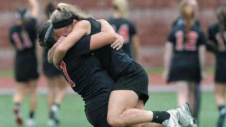 Mount Sinai's Sydney Pirreca, right, celebrates with Kasey