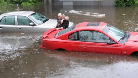 Several cars became submerged in flood water under