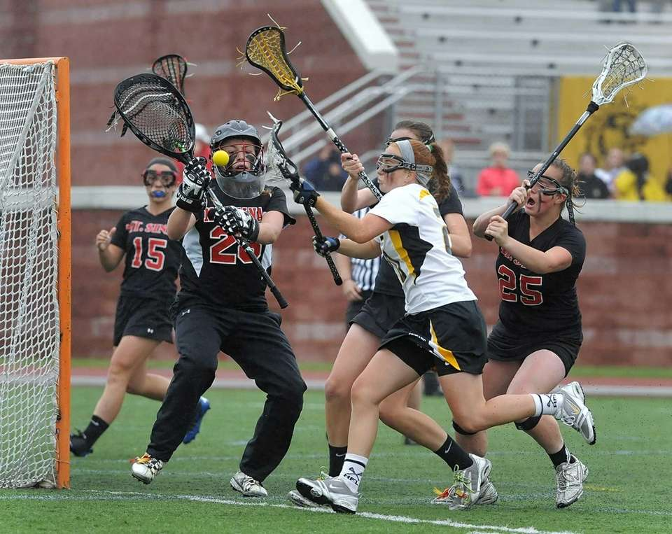 Mount Sinai's goalie Julia Michaels, left, and the