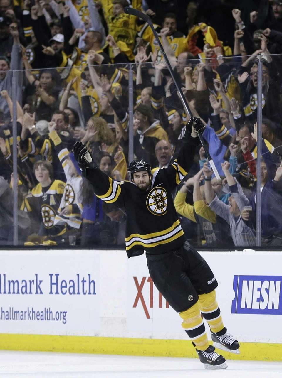 Boston Bruins defenseman Adam McQuaid celebrates his goal