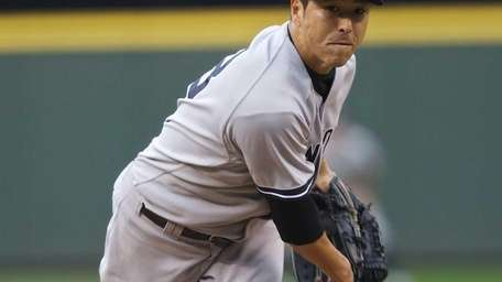 Yankees starting pitcher Hiroki Kuroda delivers during the