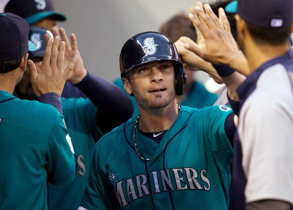 Seattle Mariners' Brendan Ryan is congratulated by teammates