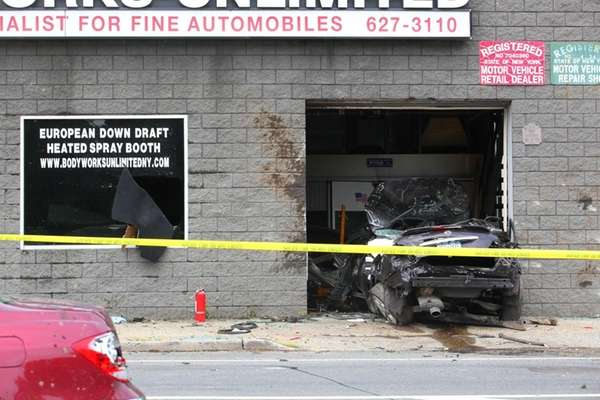A Nissan Maxima crashed into the garage entrance
