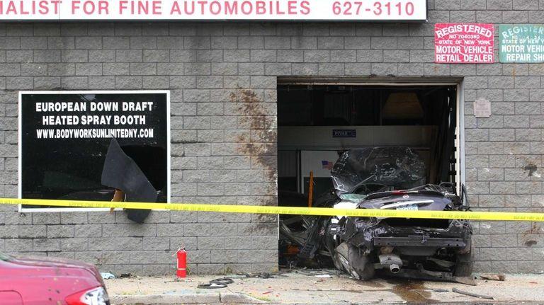 A Nissan Maxima crashed into the garage entrance