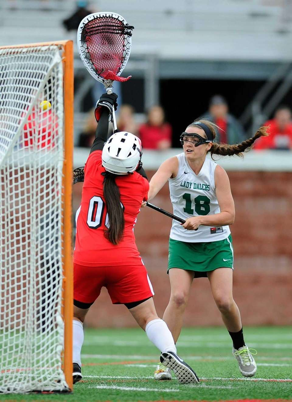 Farmingdale attacker Bridget Weill (18) takes a shot