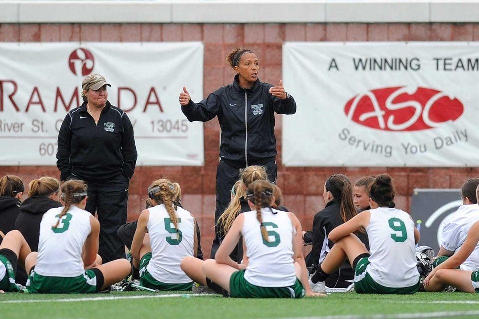 Farmingdale head coach Shari Campbell talks with her