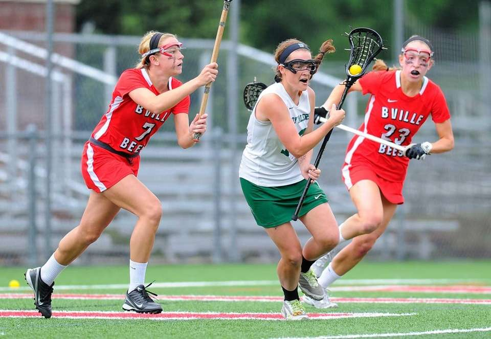 Farmingdale attacker Bridget Weill (center) dodges to the