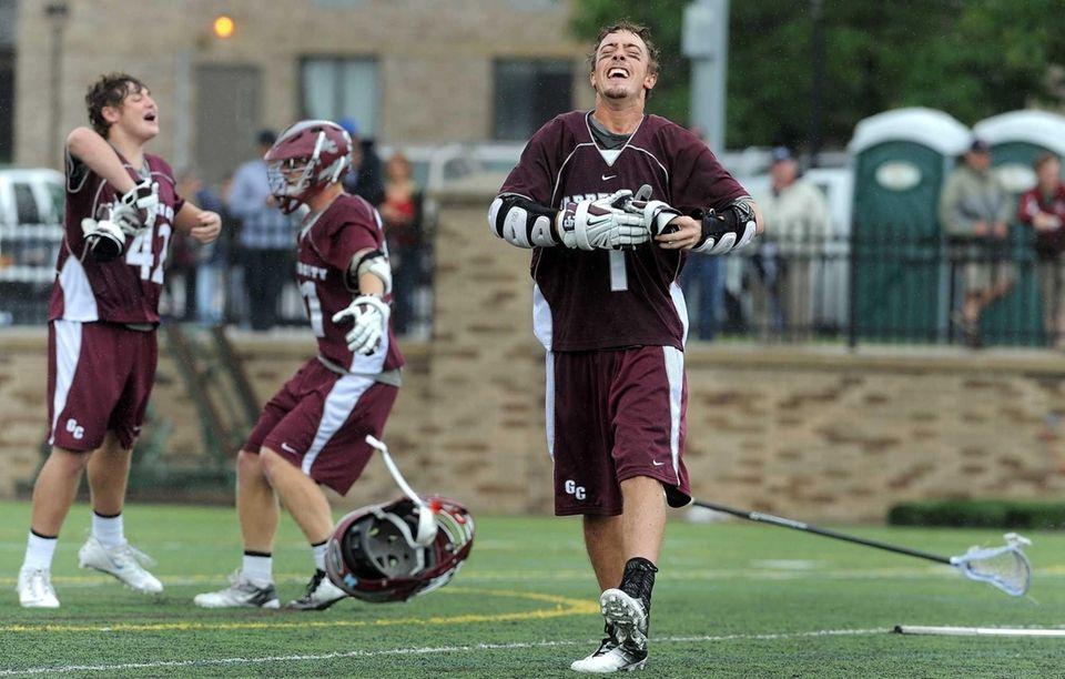 Garden City's Justin Guterding, center, and teammates celebrate