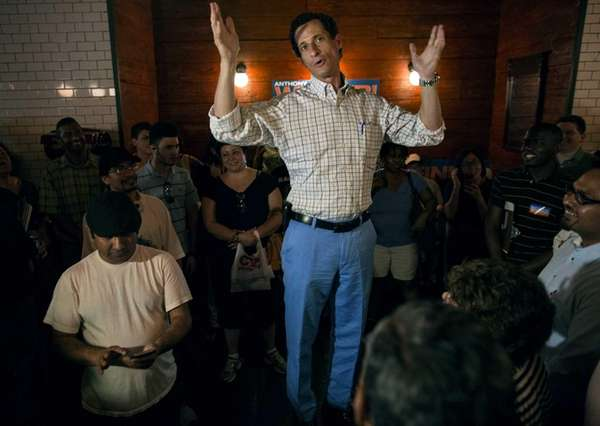 New York mayoral candidate Anthony Weiner stands above
