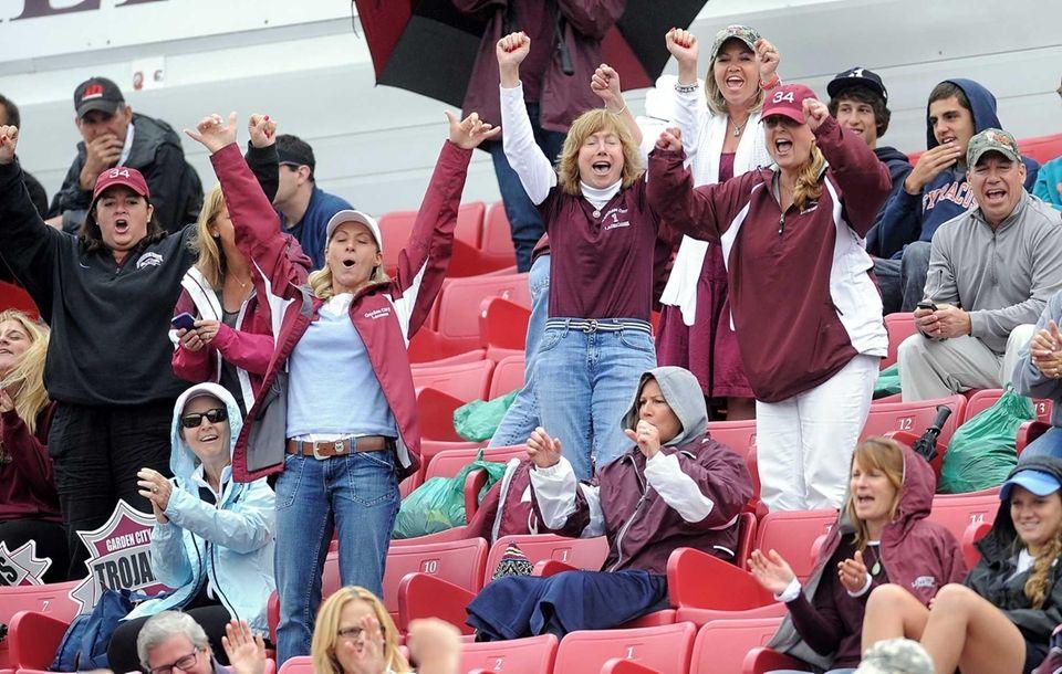 Garden City fans cheer on their team during