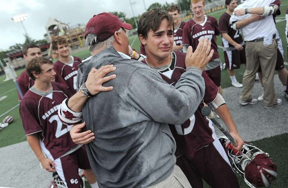 Garden City's Mike Paxton, right, is congratulated by