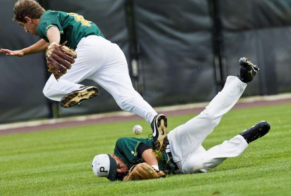 Ward Melville's Joseph Flynn avoids collision with teammate
