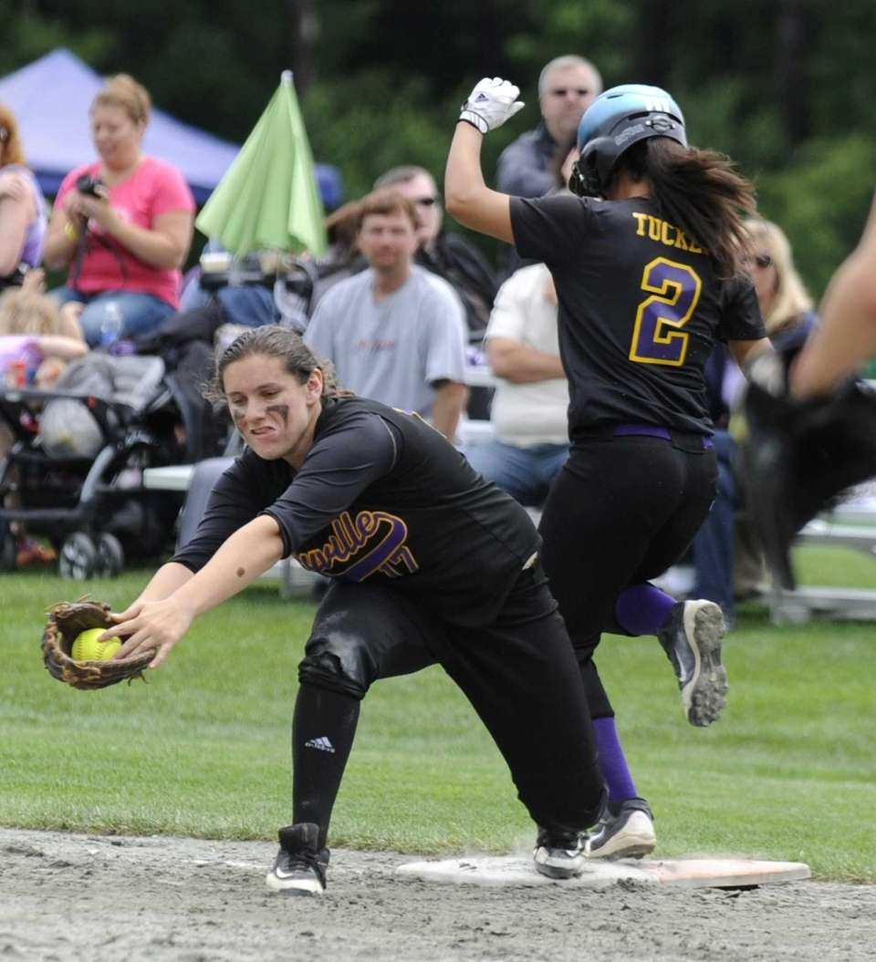 Sayville's Kristen Bricker makes the catch at first