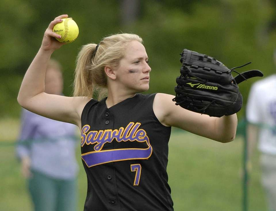 Sayville's Cindy Griffin throws from left field against