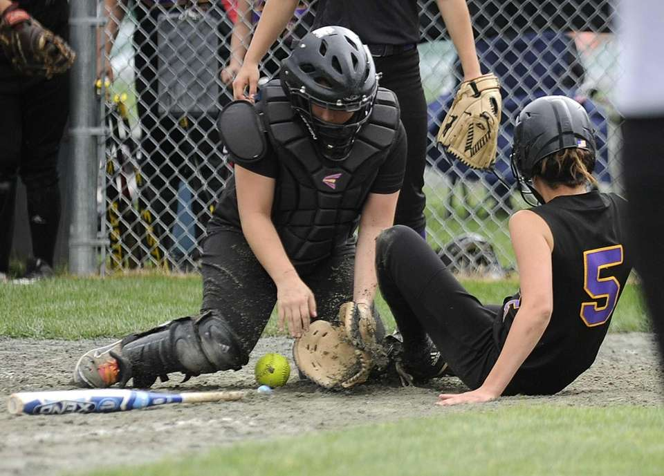Sayville's Maria Slager slides safely home as Troy