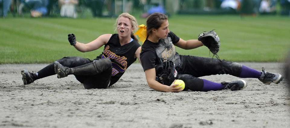 Sayville's Jackie Christensen collides with Troy's Alina Germinerio