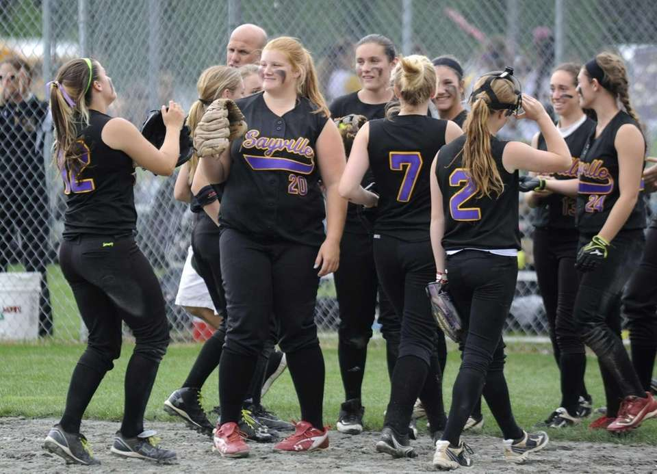 Sayville players celebrate their win over Troy in