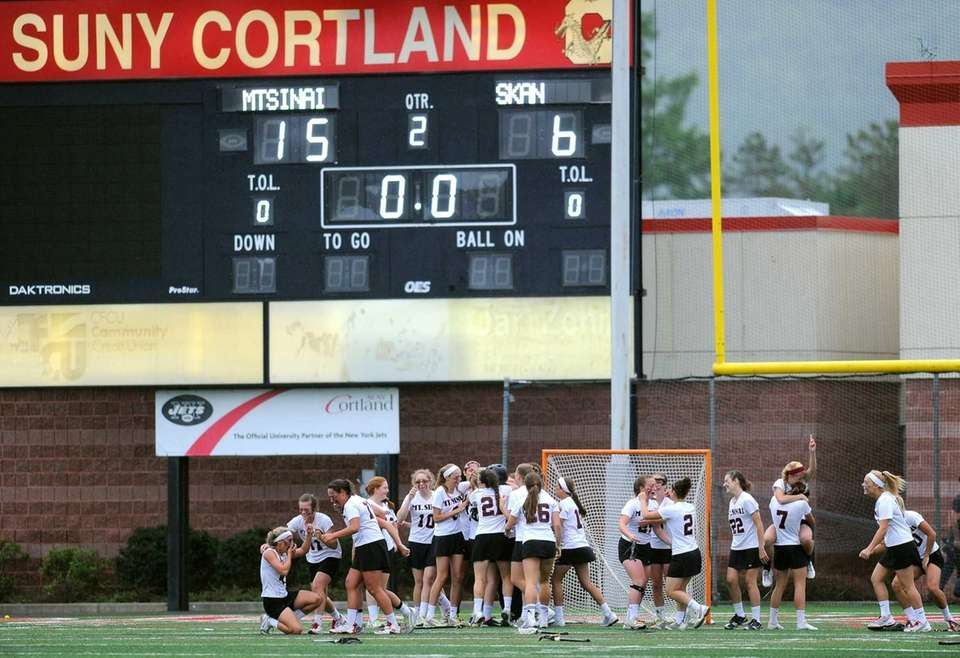 Mount Sinai players celebrate their 15-6 victory over