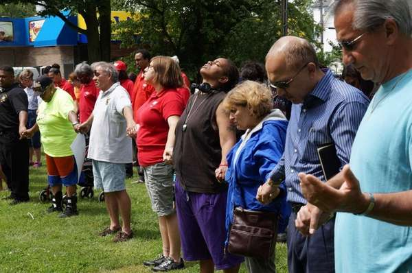 People pray during a peace rally in Brentwood.