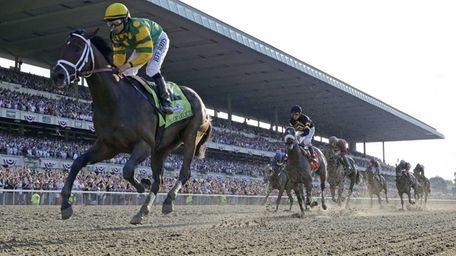 Palace Malice, left, ridden by jockey Mike Smith,