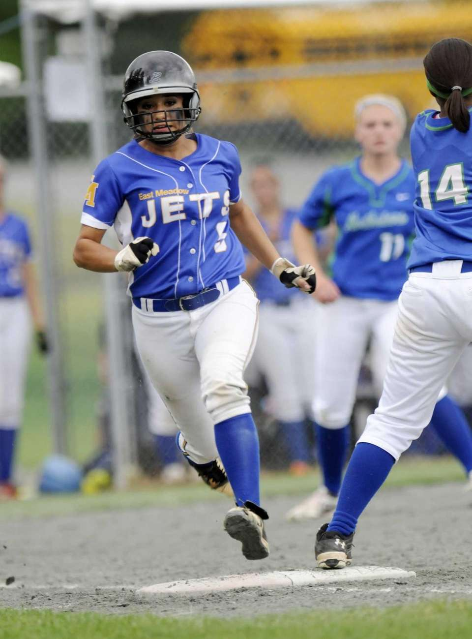 East Meadow's Taylor Conti runs to first against