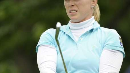 Morgan Pressel watches her tee shot on the