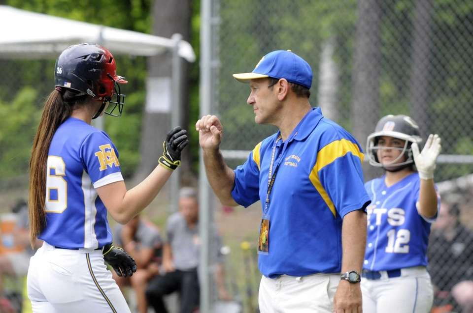 East Meadow's head coach Stewart Fritz coaches his