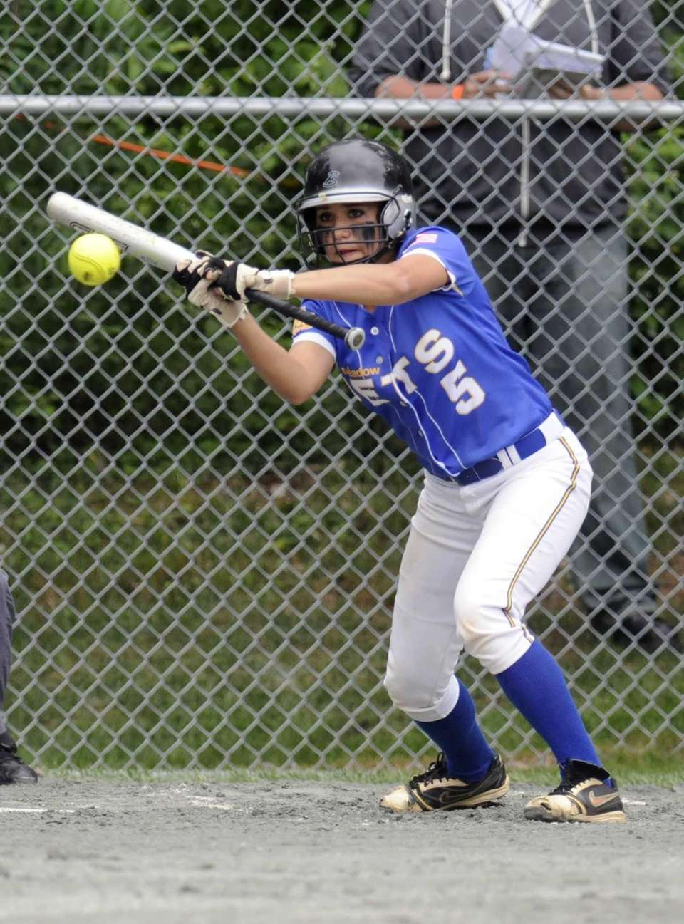 East Meadow's Taylor Conti hits a ball against