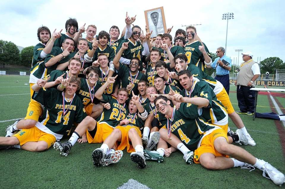 Ward Melville players and coaches pose for photos