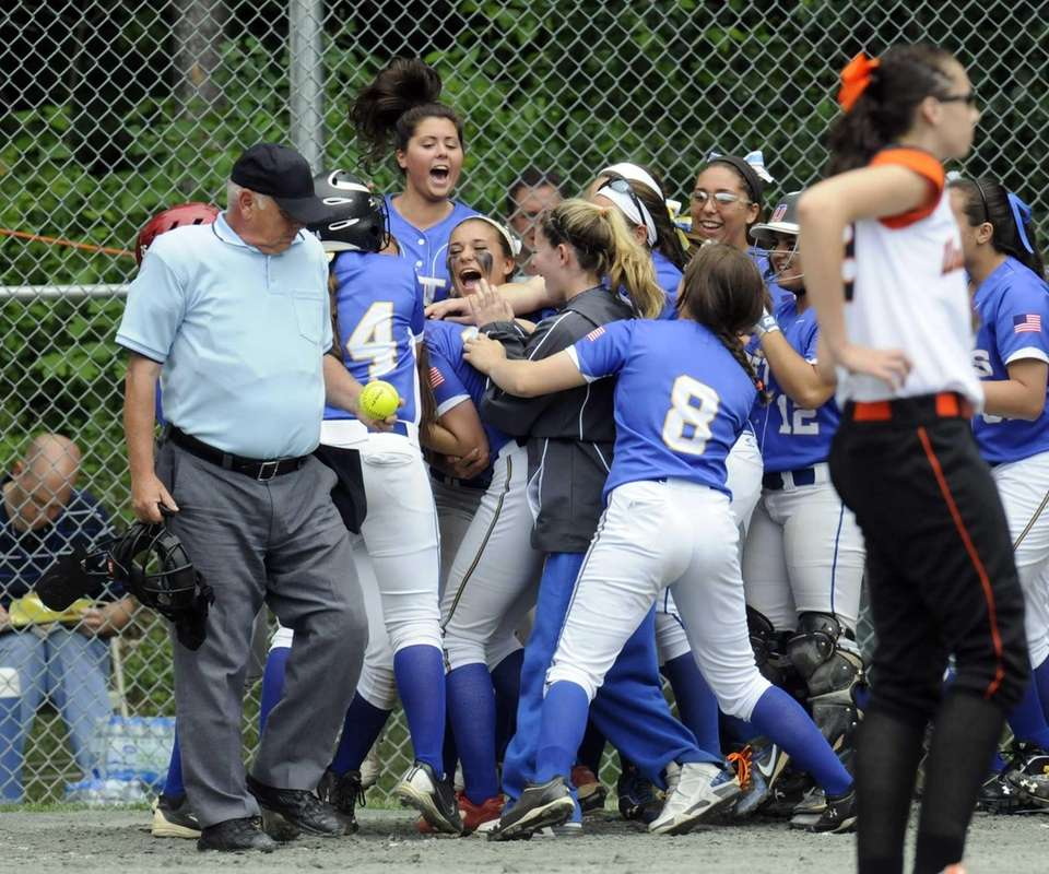 East Meadow players celebrate Kerri Shapiro's home run