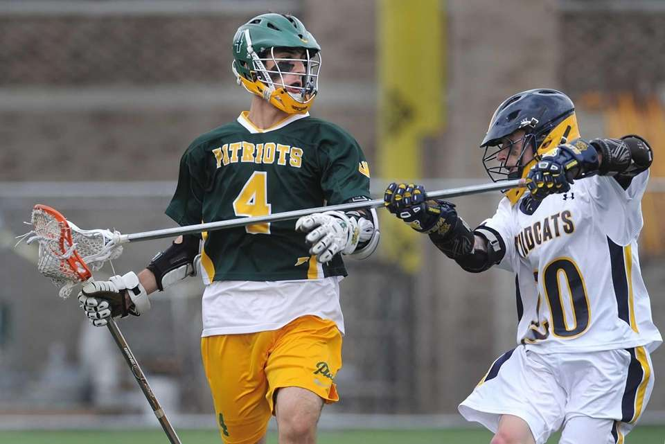 Ward Melville's Daniel Bucaro shields the ball from