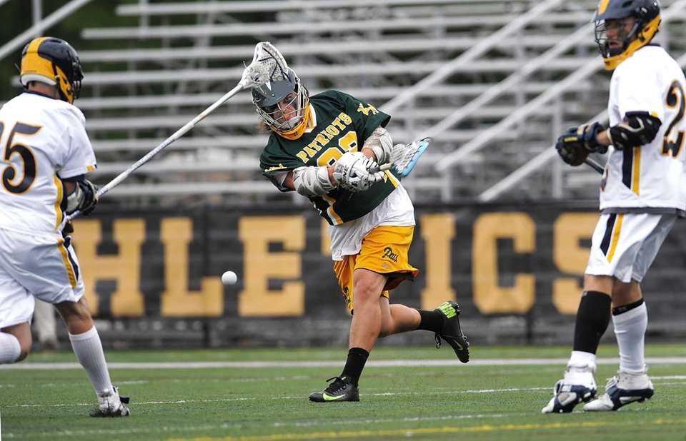 Ward Melville's Brandon Hegarty fires a shot on