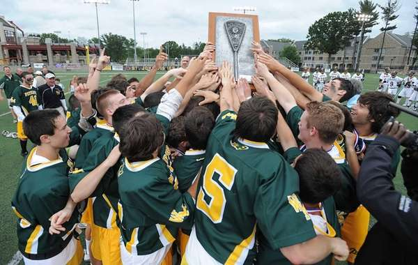 Ward Melville players hoist the state championship plaque