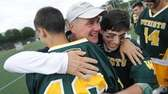 Ward Melville head coach Mike Hoppey embraces players