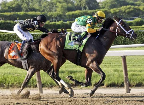 Palace Malice, right, ridden by jockey Mike Smith,