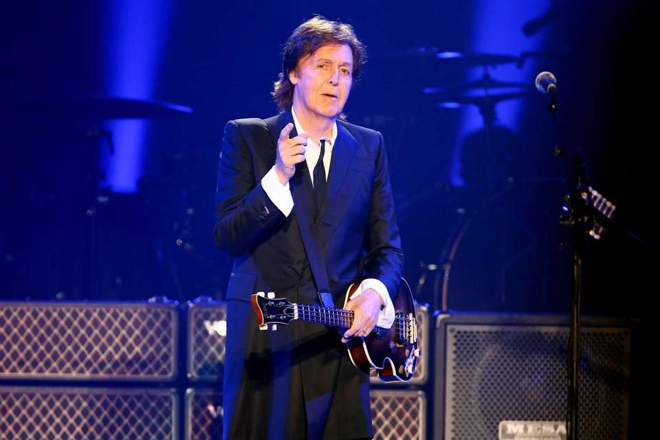 Sir Paul McCartney performs on stage during his